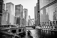 Chicago River buildings black and white picture with the Kemper Building, Leo Burnett building, United Airlines building, Marina City towers, and Trump Tower.