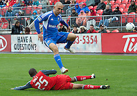 20 October 2012: Montreal Impact forward Marco Di Vaio #9 and Toronto FC defender Jeremy Hall #25 in action during an MLS game between the Montreal Impact and Toronto FC at BMO Field in Toronto, Ontario Canada. .The ended in a 0-0 draw..
