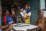 RECIFE, BRAZIL - JANUARY 9: Janaina Helena de Menezes, a supervisor for the Environmental Health Department, speaks with residents about about how to clean up standing water, which provides perfect breeding ground for the zika-carrying mosquitoes, in Recife, Pernambuco, Brazil, on Saturday, Jan. 9, 2016<br />  <br /> The mosquito-borne Zika virus continues to spread in Brazil, alarming health officials and expecting mothers that their babies will be born with abnormal brain development called microcephaly. While researchers have yet to make a connection, Brazil has the highest number of babies born with mircocephaly - the most cases in Recife, Pernambuco - from mothers who tested positive to the Zika virus. There are about 3,530 suspected cases of zika-related microcephaly in Brazil.