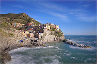 From part of the trail between Manarola and Corniglia, this image of the Cinque Terre looking back at Manarola gives you a nice view of the small, colorful fishing village on a bright afternoon. I used a filter on this picture to slow down the action of the waves, giving the Ligurian Sea a misty look.