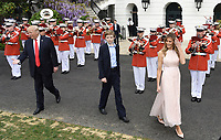 United States President Donald Trump , First Lady Melania Trump and son Barron Trump attend the annual Easter Egg Roll on the South Lawn of the White House  in Washington, DC, on April 17, 2017. <br /> CAP/MPI/CNP/RS<br /> &copy;RS/CNP/MPI/Capital Pictures