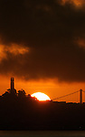 The sun rose off the San Francisco horizon with the Coit Tower and a bridge framing the fireball.