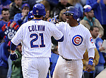CHICAGO - APRIL  05:  Tyler Colvin #21 is greeted at home plate by Marlon Byrd #24 of the Chicago Cubs hits after Colvin hit a two-run home run in the third inning against the Arizona Diamondbacks on April 5, 2011 at Wrigley Field in Chicago, Illinois.  The Cubs defeated the Diamondbacks 6-5.  (Photo by Ron Vesely) Subject: Tyler Colvin;Marlon Byrd