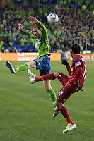 Real Salt Lake defender Javier Morales, right, kicks the ball over Seattle Sounders FC midfielder Erik Friberg during play in a Major League Soccer Wester Conference Semifinal match at CenturyLink Field in Seattle Wednesday November 2, 2011. The Sounders won the match 2-0, but lost the series.