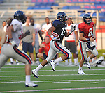 Ole Miss' Donte Moncrief (12) runs during a team scrimmage at Vaught-Hemingway Stadium in Oxford, Miss. on Saturday, August 20, 2011.