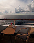 Morning coffee is served on the balcony of M/S Ryndam of the Holland America line, at sea in the Caribbean.