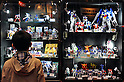 Tokyo, Japan - March 24: A visitor took a look at figures of Gundam, Japanese popular animation for years, at Tokyo International Anime Fair at Tokyo Big Sight, Koto, Tokyo, Japan on March 24, 2012. The fair was the largest animation exhibition in the world, and 216 companies had their booths to show their products.