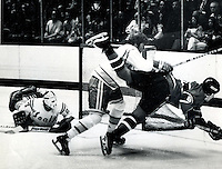 Seals action, Bobby Stewart knocks Canadiens player out of the way to help Gilles Meloche in the net..(1974 photo by Ron Riesterer)