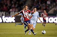 Chivas USA defender Jimmy Conrad (12) passes one off. Sporting KC defeated CD Chivas USA 3-2 at Home Depot Center stadium in Carson, California on Saturday March 19, 2011...