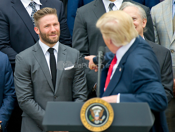United States President Donald J. Trump gestures towards New England Patriots wide receiver Julian Edelman (11) as he makes remarks welcoming the Super Bowl Champion New England Patriots to the South Lawn of White House in Washington, DC on Wednesday, April 19, 2917.<br /> Credit: Ron Sachs / CNP/MediaPunch<br /> <br /> (RESTRICTION: NO New York or New Jersey Newspapers or newspapers within a 75 mile radius of New York City)