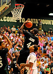 13 February 2011: Binghamton University Bearcat forward Mahamoud Jabbi, a Senior from  Serrekunda, Gambia, in action against the University of Vermont Catamounts at Patrick Gymnasium in Burlington, Vermont. The Catamounts came from behind to defeat the Bearcats 60-51 in their America East matchup. The Cats took part in the National Pink Zone Breast Cancer Awareness Program by wearing special white jerseys with pink trim. The jerseys were auctioned off following the game with proceeds going to the Vermont Cancer Center. Mandatory Credit: Ed Wolfstein Photo