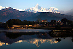 "Fishtail Mountain, in the Annapurna Range, as seen from Sarangkot, a Himalaya viewing spot near the popular town of Pokhara. Fishtail may not be the highest summit of the Himalayas, but it is one of the most dramatic thanks to its shape, which looks like a ""fishtail"" to Nepali eyes. Phewa Tal or Lake Fewa is the second largest lake in Nepal. On a clear day, majestic views of the Annapurna Range of the Himalayas reflects on the lake. Phewa Tal or Lake Fewa is the second largest lake in Nepal. On a clear day, majestic views of the Annapurna Range of the Himalayas reflects on the lake."