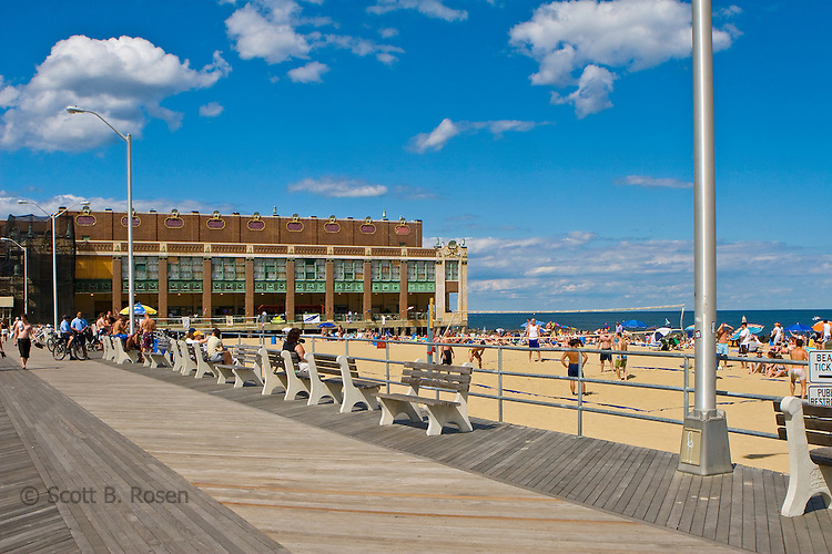 Summer on the newly rebuilt boardwalk and daily groomed beach with Convention Hall in the background, Asbury Park, New Jersey