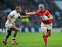 Jonathan Davies of Wales looks to fend Jonathan Joseph of England. RBS Six Nations match between England and Wales on March 12, 2016 at Twickenham Stadium in London, England. Photo by: Patrick Khachfe / Onside Images