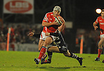 Jon Davies is tackled by Hayden Thomas. Scarlets V Bristol, EDF Energy Cup  © Ian Cook IJC Photography iancook@ijcphotography.co.uk www.ijcphotography.co.ukUnholy Alliance Tour 2008,
