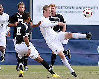 Ian Christianson #6 of Georgetown University boots the ball past Marc Cintron #9 of Providence University during a Big East quarter-final  match at North Kehoe Field, Georgetown University on November 6 2010 in Washington D.C. Providence won 2-1.