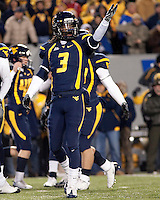 WVU defensive back Eddie Davis urges on the crowd. The West Virginia Mountaineers defeated the Pittsburgh  Panthers 19-16 on November27, 2009 at Mountaineer Field at Milan Puskar Stadium, Morgantown, West Virginia.