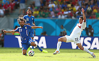 Andrea Pirlo of Italy and Jose Cubero of Costa Rica in action