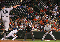 Doug Fister #58 of the Seattle Mariners throws to Casey Kotchman #13 in an attempt to get Brian Roberts #1 of the Baltimore Orioles out at first during a MLB game at Camden Yards, on August 8 2010, in Baltimore, Maryland. Orioles won 5-4 in extra innings.