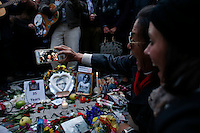 Fans take a selfie next to a memorial set up for John Lennon around the 'Strawberry Fields' in Central Park during the 35-year anniversary of his death in New York December 8, 2015. The death of John Lennon still reverberates as a defining moment for a generation and for the music world. Police said the shooting occurred outside the Dakota, the century-old luxury apartment house where Lennon and his wife, Yoko Ono, lived. It is across the street from Central Park. Kena Betancur/VIEWpress.