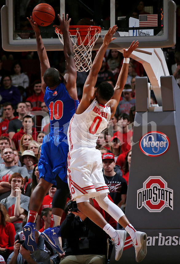 Jahad Thomas (10) of UMass-Lowell is guarded by D'Angelo Russell (0) of Ohio State during the second half of Friday's NCAA Division I men's basketball game at the Value City Arena in the Jerome Schottenstein Center in Columbus on Nov. 14, 2014. Ohio State won the game 92-55. (Dispatch Photo by Barbara J. Perenic)