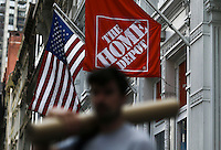 New York, USA. 19 August 2014. A man carries a package outside of   Home Depot store at 23rd street while Home Depot company prepares its Quarterly results at the Stock Exchange in New York.  Eduardo Muñoz Alvarez/VIEWpress