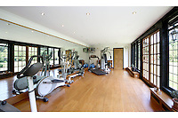 BNPS.co.uk (01202 558833).Pic: Savills/BNPS..***Please use full byline***..Modern Bonds can work out in this well equipped gym...This quintessentially English property a short Aston Martin drive from the centre of London is leaving potential buyers shaken and stirred...Its the former home of James Bond star Roger Moore, where he lived when he shot his first three 007 movies in the 1970's...Sherwood House lies 20 miles west of central London in the village of Denham, Bucks...Moore's former home includes five bedrooms, a drawing room, study, library, gym, conservatory and of course a snooker room, wine cellar and swimming pool...The 11-acre property also has an annexe and guesthouse...Moore was the longest serving James Bond actor, spending 12 years in the role and featuring in seven Bond films from 1973 to 1985...Any potential buyers wanting to live the life of one of Her Majestys Secret Agents will have to find £4.5 million for the property.