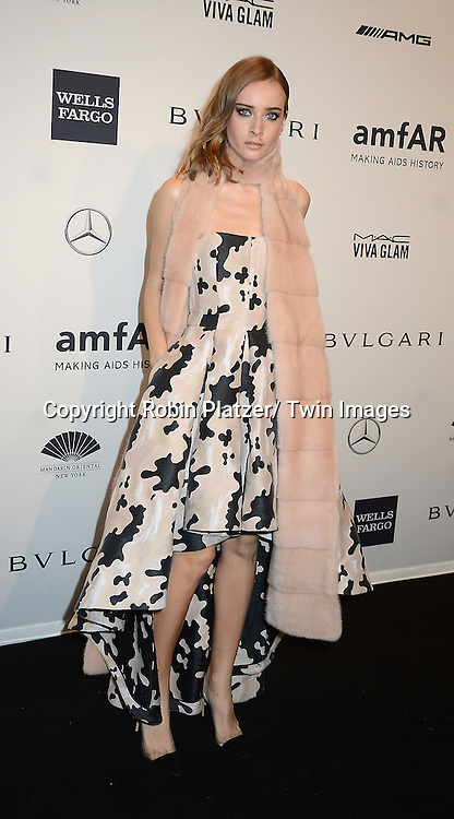 Olga Sorokina attends the amfAR New York Gala on February 5, 2014 at Cipriani Wall Street in New York City.