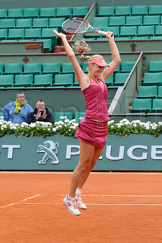 09.06.2013 Paris, France. Ekaterina Makarova of Russia celebrates her win after the match  against Sara Errani of Italy and Roberta Vinci of Italy in the Women's Doubles Final of the French Open from Roland Garros.