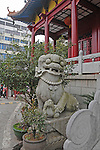 stone statue of female dragon flanking the stairway of a Buddhist temple in Guilin, China