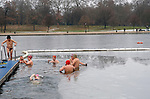 Christmas Day Morning Swim. Serpentine Lido Swimming Club London. Annual 100 metre Peter Pan Cup race cancelled due to ice. Uk.