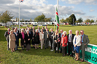 Lord Lieutenant of Nottinghamshire Sir Andrew Buchanan (right) and President of the Newark & Nottinghamshire Agricultural Society Mitch Stevenson OBE (second from right) raise the flag to start the show at Friday night's dinner along with some of the vip guests.