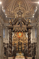 Papal Altar  with Bernini's baldacchino, 1633, Saint Peter's Basilica, Vatican City, Rome, Italy. The mainly bronze, partly gilt altar is Bernini's first work in St. Peter's. In the background stands the Cathedra Petri, Altar of the Chair of St. Peter, created by Bernini in 1666, with four gigantic statues of Doctors of the Church: St. Ambrose, St. Anthanasius (left); and St. John Chrysostom, St. Augustine (right) Picture by Manuel Cohen