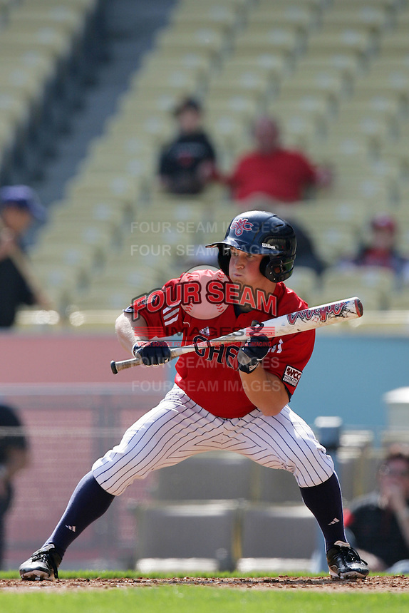 Cole Norton #8 of the St.Mary's Gaels bunts against the Georgia Bulldogs at Dodger Stadium in Los Angeles,California on March 13, 2011. Photo by Larry Goren/Four Seam Images