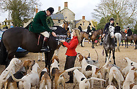 Members of Heythrop Hunt are offered drinks outside the Westcote Inn, Oxfordshire, United Kingdom