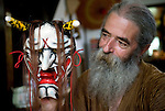 Briton Jake Davies poses for a photo with one of his Iwami-Kagura masks -- the female demon Hanya from Iwami-Kagura dance -- at his home in Sakurae Village, Shimane Prefecture, Japan on 28 June 2011..Photographer: Robert Gilhooly