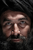 Sayed Mohammad Akbar Agha is the former leader of Jaish-al-Muslimeen (Army of Muslims) which broke away from the mainstream Taliban in 2001. As the head of this new group, which was believed to have concentrated their operations in the south of Kabul, Akbar conducted attacks on U.S. military convoys and re-supply lines. In 2004 he was sentenced to 16-years in prison for kidnapping and threatening to decapitate three foreign UN workers in the capital Kabul. In 2009 president Hamid Karsai pardoned him and released him from prison.Free Syria Army soldiers stand guard at their base in the Bustan Al-Bashar neighborhood of Aleppo on the last day of a U.N. negotiated seize fire that began on the first day of the Muslim holiday of Eid. Both sides exchanged small arms fire as the regime fired mortars throughout the day on several sectors of the city - the kurdish neighborhood of Ashrafya was also bombed by regime jets on October 29, 2012, following an FSA incursion in the district on Saturday...© Javier Manzano...