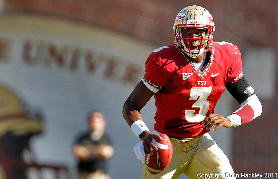 TALLAHASSEE, FL 10/22/11-FSU-MARY102211 CH-Florida State quarterback EJ Manuel scrambles against Maryland during first half action Saturday at Doak Campbell Stadium in Tallahassee. .COLIN HACKLEY PHOTO