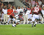 Ole Miss wide receiver Vince Sanders (10) is tackled by Alabama defensive back Deion Belue (13) at Bryant-Denny Stadium in Tuscaloosa, Ala. on Saturday, September 29, 2012.