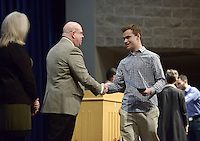 NWA Democrat-Gazette/BEN GOFF @NWABENGOFF<br /> Dylan Moore, a sophomore at Rogers Heritage High, shakes hands with Lance Arbuckle, principal of Rogers New Technology High School, as he walks the stage to receive his certificate of enrollment Sunday, Feb. 12, 2017, during an induction ceremony for the inaugural class of the Rogers Honors Academy at Rogers High School.