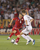 Czech Republic midfielder Jan Polak (8) controls the ball as USA defender Clarence Goodson (21) defends. In the Send Off Series, the Czech Republic defeated the US men's national team, 4-2, at Rentschler Field in East Hartford, Connecticut, on May 25, 2010.