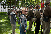 Zack Watkins stands with other Civil War re-enactors from the 26th NC Infantry on the grounds of the Old State Capitol to hear the declaration of secession from the Union 150 years after the fact.