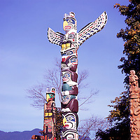 Totem Poles at Brockton Point in Stanley Park, Vancouver, British Columbia, Canada, in Spring.  From left to right: ; Kwakwaka'wakw (Kwakiutl) - called Oscar Maltipi Pole, with Thunderbird sitting above Killer Whale; Kwakwaka'wakw (Kwakiutl) - called Kakaso'las, with Thunderbird sitting above Sea Bear sitting above Bak'was (Wild Man of the Woods); and Nisga'a (Nishga) - called Beaver Crest Pole.