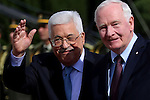 Palestinian President Mahmoud Abbas and Canada's Governor General David Johnston gesture during a welcome ceremony in the West Bank city of Ramallah on November 4, 2016. Photo by Shadi Hatem