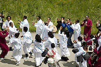 Switzerland. Canton Valais. St-Maurice. Africa Saints Pilgrimage (P&egrave;lerinage aux Saints d'Afrique). Religious <br /> procession. The people, dressed in white, are originally from Eritrea. They walk in front of the procession and dance following the tempo of a drum.The procession goes from V&eacute;roliez  a quarter of St-Maurice to St-Maurice's abbey.  2.06.13 &copy; 2013 Didier Ruef
