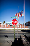 Flags fly at half mast in Tucson, Arizona on January 9th, 2011.  Scenes from Tucson, Arizona in the days following a mass shooting that left six dead and [number] injured.  The shooter, identified as Jared Loughner, was captured at the scene and charged in federal court on January 9th, 2011.  Among the injured was democratic congresswoman Gabrielle Giffords.  The dead included a federal judge, a nine year-old girl, and several septaugenarians who had all come to see the congresswoman at one of her 'Congress on the Corner' events.