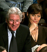 Washington, D.C. - January 4, 2007 --  Actor Richard Gere and his wife, Carey Lowell, watch from the gallery as United States Representative Nancy Pelosi (Democrat of the 8th District of California) is sworn-in as the Speaker of the United States House of Representatives in the Capitol in Washington, D.C. on Thursday, January 4, 2007.  Speaker Pelosi is the first woman in U.S. history to serve in that position..Credit: Ron Sachs / CNP
