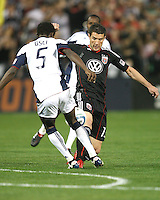 Chris Pontius #13 of D.C. United goes for the ball with Emmanuel Osei #5  of the New England Revolution during an MLS match on April 3 2010, at RFK Stadium in Washington D.C.
