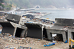 Photo shows the shattered waterfront harbor area of a community on the outskirts of Kamaishi, Iwate Prefecture, Japan on 12 June 2011.  Photographer: Robert Gilhooly