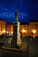 The statue of friar Andrija Kacic-Miosic overlooks the town square, Kacicev trg, at night in the town of Makarska, Croatia